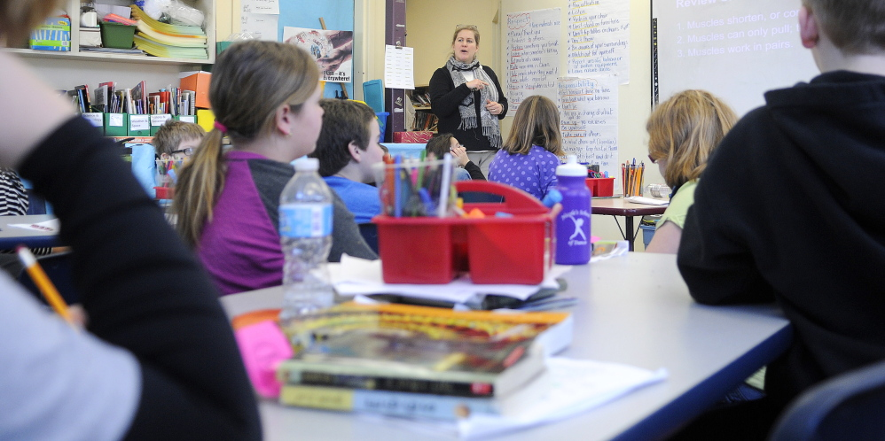 CRUNCH: Fourth grade teacher Sarah Hanley instructs Thursday in a room at the Helen Thompson School in West Gardiner that once served as the school's art classroom.