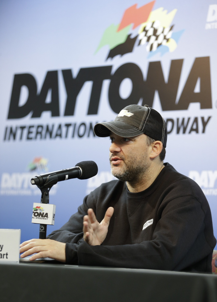 NASCAR driver Tony Stewart answers questions at a news conference during Sprint Cup auto racing testing at Daytona International Speedway in Daytona Beach, Fla., on Thursday.