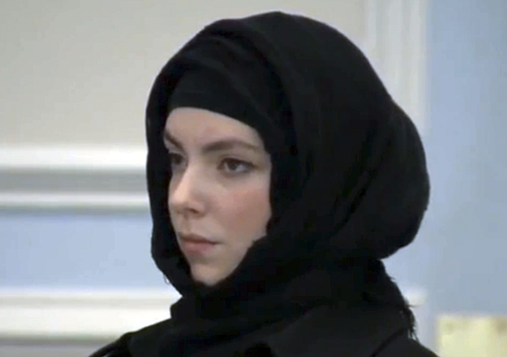 Katherine Russell, widow of Boston Marathon bombing suspect Tamerlan Tsarnaev, stands during a hearing in district court Thursday in Wrentham, Mass., on charges of driving with a suspended license, speeding and driving an unregistered motor vehicle in Franklin, Mass., in August.
