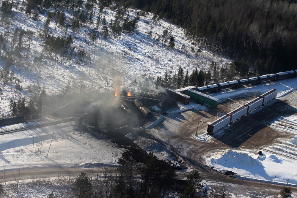 This aerial photo shows derailed Canadian National Railway cars burning in Plaster Rock, New Brunswick, on Wednesday.