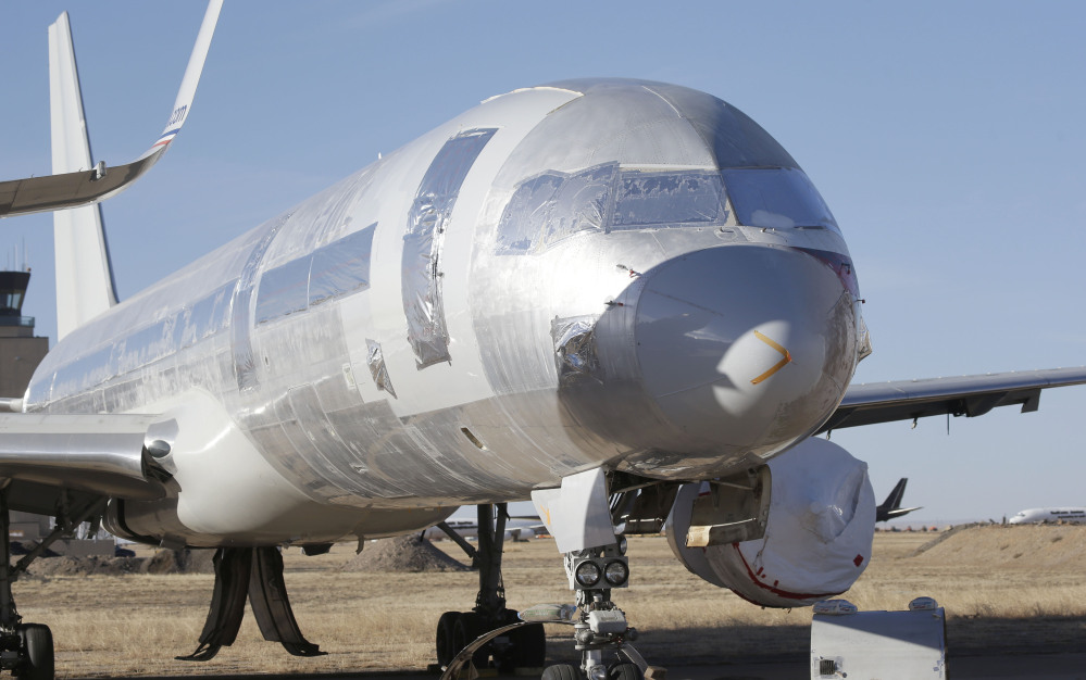 A retired American Airlines jet is parked in Roswell, New Mexico. The decision to scrap old planes and buy new ones is being driven by high fuel prices, low interest rates and Wall Street financing mechanisms that allow airlines with junk bond ratings to borrow money at favorable terms.