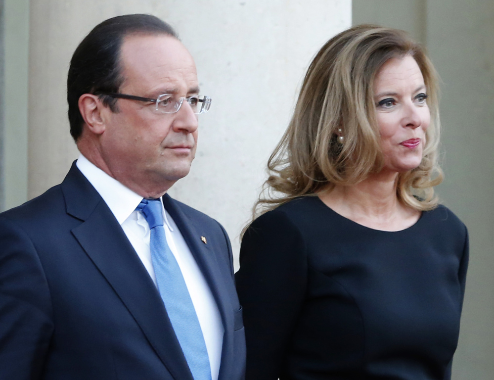 French president Francois Hollande and his companion, Valerie Trierweiler, wait for German President Joachim Gauckand at the Elysee Palace in Paris in this Sept. 3, 2013, photo.