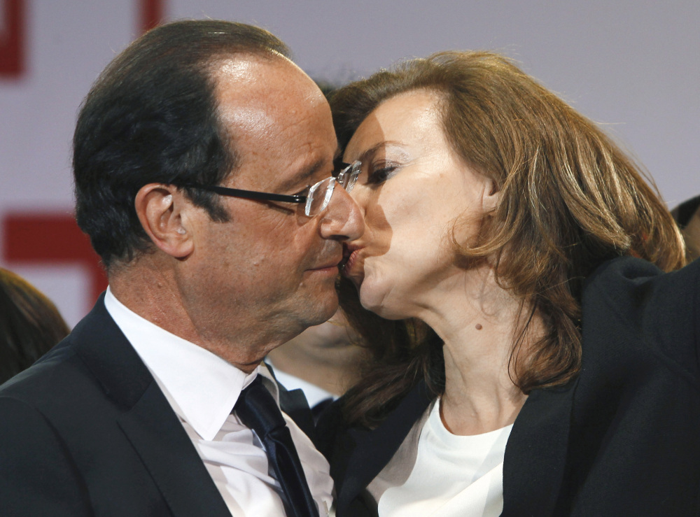 French president-elect Francois Hollande kisses his companion, Valerie Trierweiler, after greeting crowds gathered to celebrate his election victory in Bastille Square in Paris in this May 6, 2012, photo.