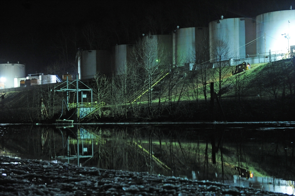 Crews clean up a chemical spill along the Elk River in Charleston, W.Va., which compromised the public water supply of nine counties on Thursday.