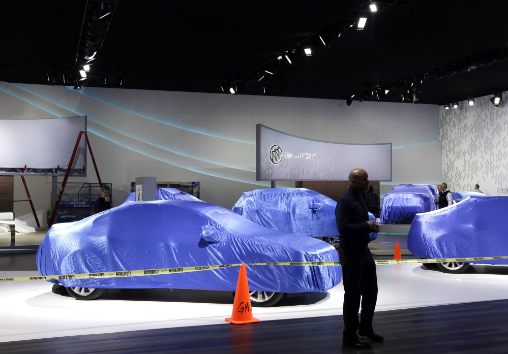 General Motors vehicles are seen under wraps at the Cobo Center, home of the North American International Auto Show in Detroit. What the automakers introduce is crucial because sales growth is starting to slow and new models tend to capture more buyers than older ones.
