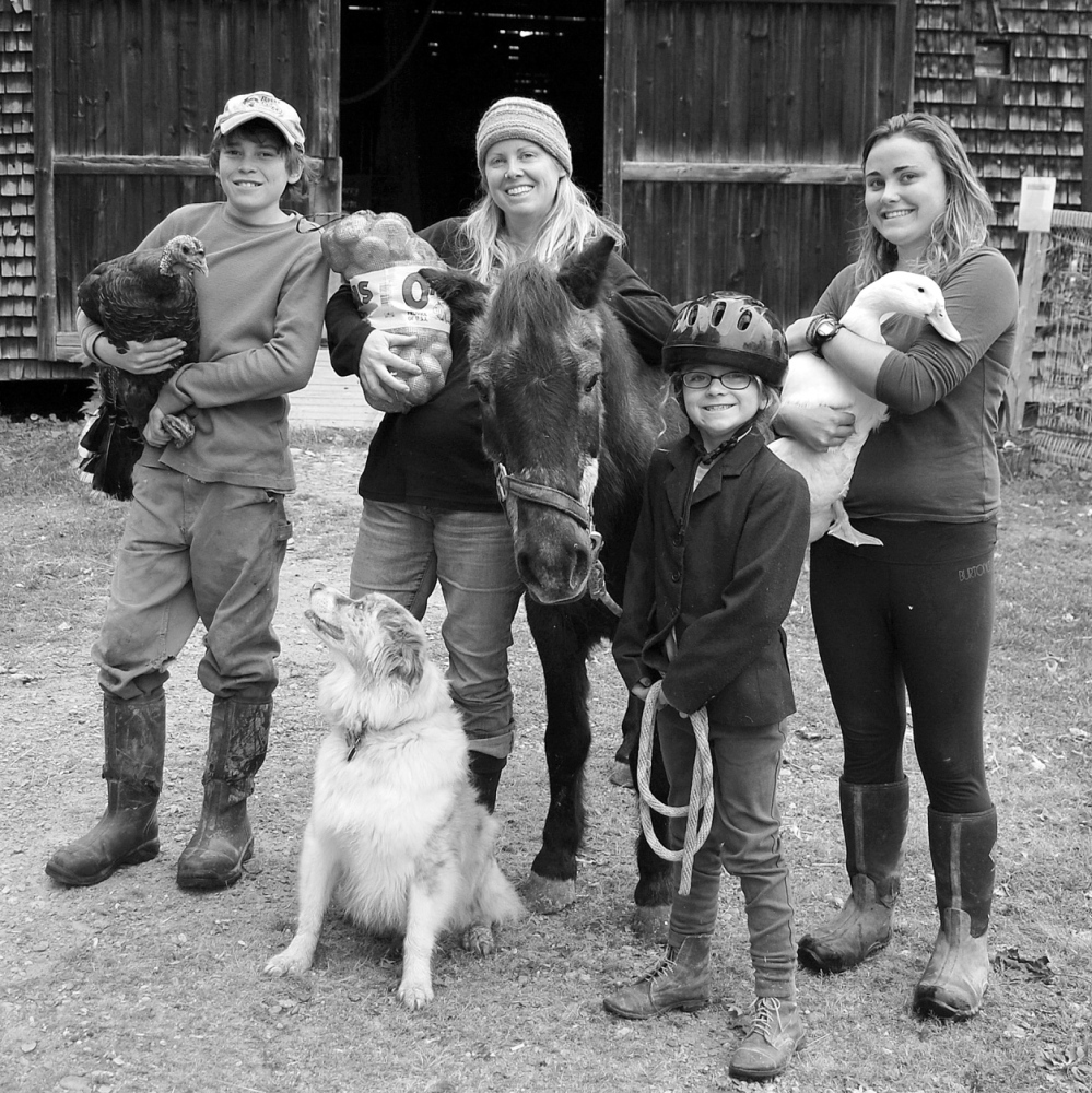 ARTISTS' MUSES: Allison McKeen's photos of 10 local organic farmers, including the Perry family from Winterberry Farm in Belgrade, were the basis for the collaborative portraits created by students at 10 central Maine schools. The finished portraits will be on display at the University of Maine at Augusta's Danforth Gallery from Thursday through Feb. 21.