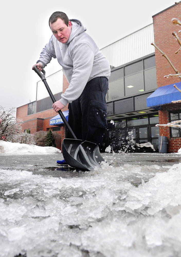 ice work: Jeremy Beeney scrapes ice off the sidewalk Saturday in front of the Augusta Civic Center in the aftermath of an early morning freezing rainstorm. Beeney and the other civic center maintenance workers were busy keeping roads and walks clear for the people attending the Northeast Motorsports Show that runs through Sunday.