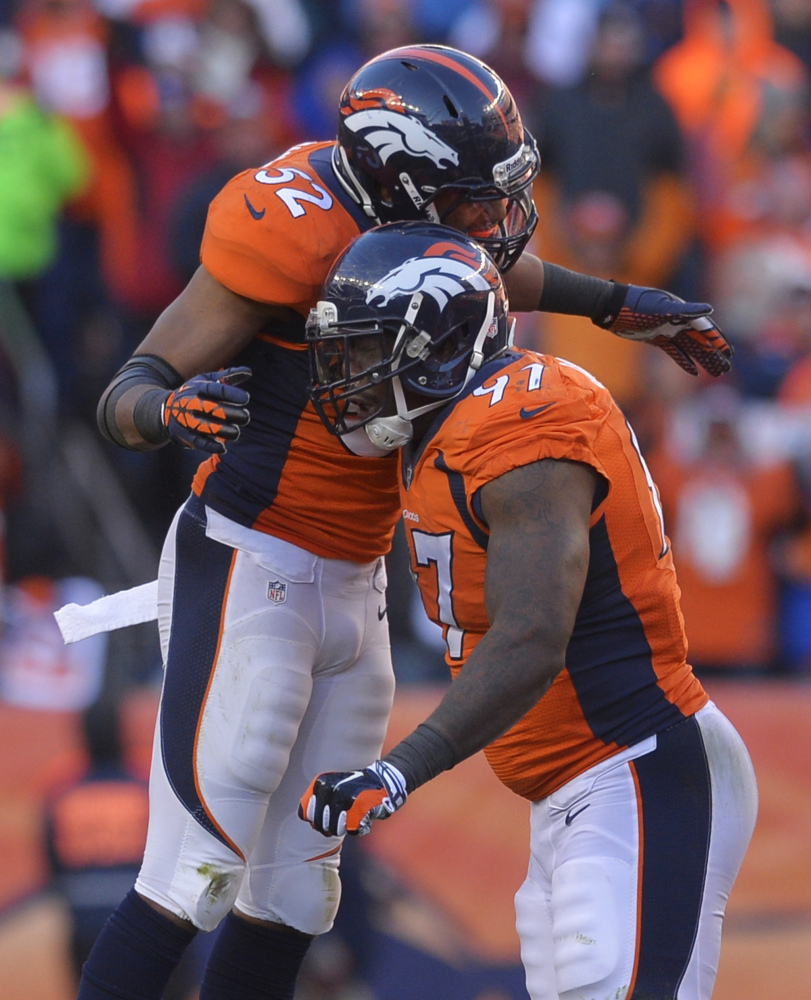Denver Broncos middle linebacker Wesley Woodyard (52) and Denver Broncos defensive end Malik Jackson (97) react after sacking San Diego Chargers quarterback Philip Rivers (17) in the second quarter of an NFL AFC division playoff football game, Sunday, Jan. 12, 2014, in Denver. (AP Photo/Jack Dempsey)