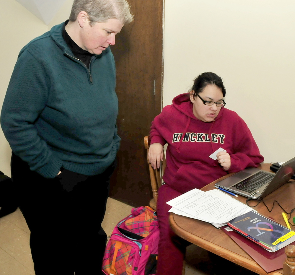 STUDY: Teresa Smith, left, director of admissions, career and transfer services at Kennebec Valley Community College, helps Good Will-Hinckley student Tyneshia Wright with a school project recently. Wright is taking part in the College Step Up program.