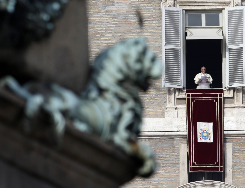 Pope Francis reads the list of 19 new Cardinals during the Angelus prayer in St. Peter's Square, at the Vatican on Sunday.