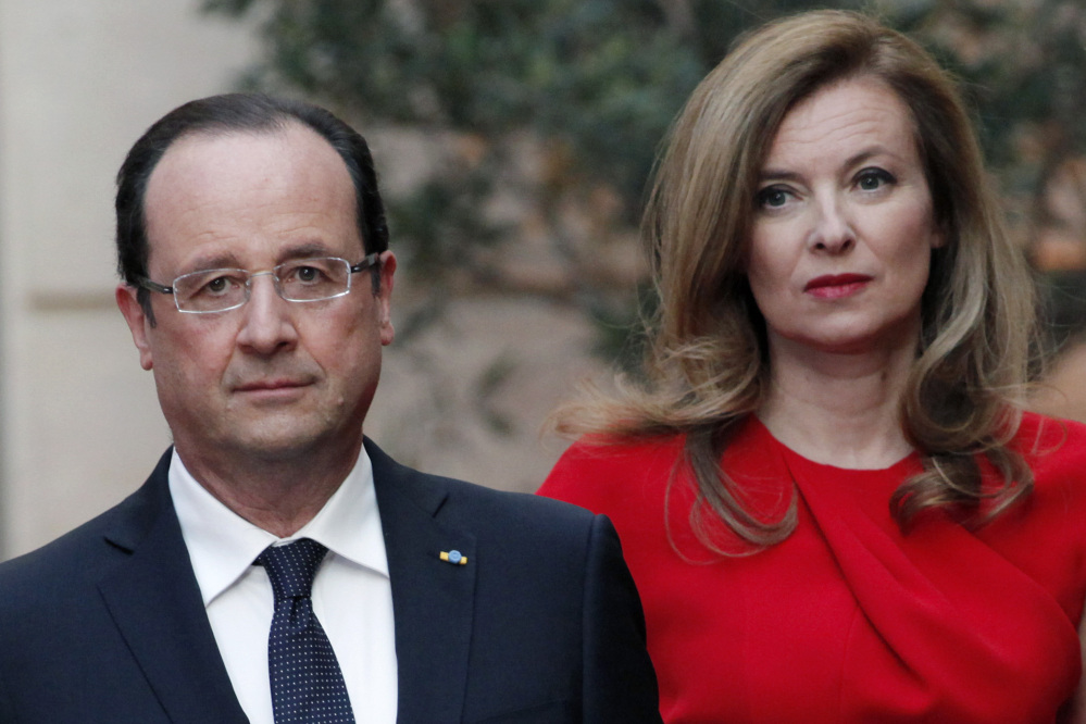 French President Francois Hollande, left, and his companion Valerie Trierweiler, who has been hospitalized after a report that the president is having an affair with an actress.