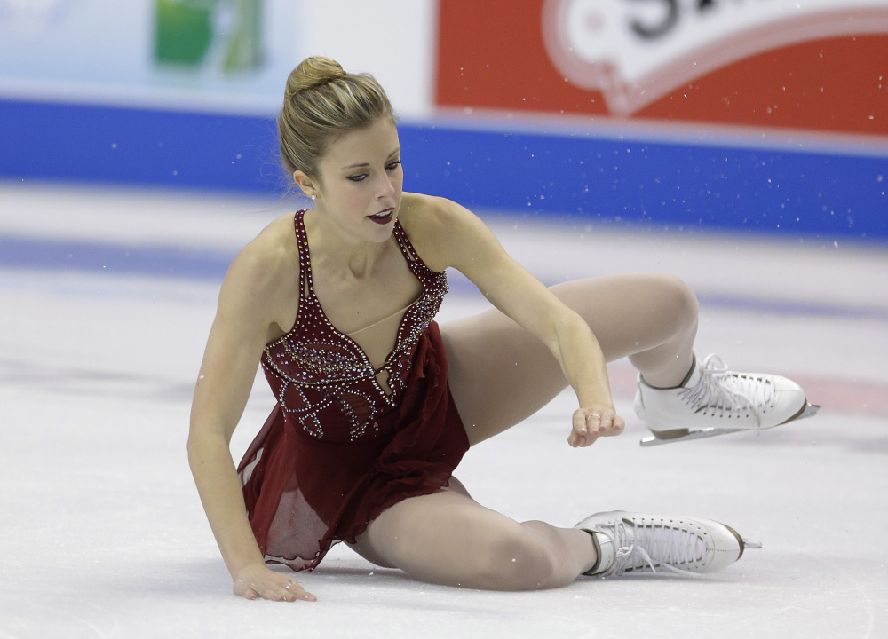 Ashley Wagner falls as she competes in the women's free skate at the U.S. Figure Skating Championships on Saturday in Boston. Wagner, a two-time U.S. champion, was selected for the U.S. Olympic team based on her past performances.