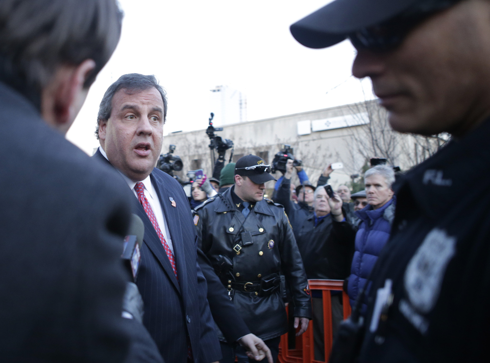 New Jersey Gov. Chris Christie leaves after a visit City Hall Thursday, in Fort Lee, N.J.