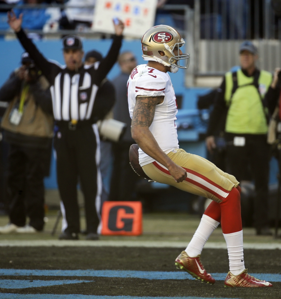 San Francisco 49ers quarterback Colin Kaepernick (7) celebrates his touch-down run against the Carolina Panthers during the second half of a divisional playoff NFL football game, Sunday, Jan. 12, 2014, in Charlotte, N.C. (AP Photo/John Bazemore)