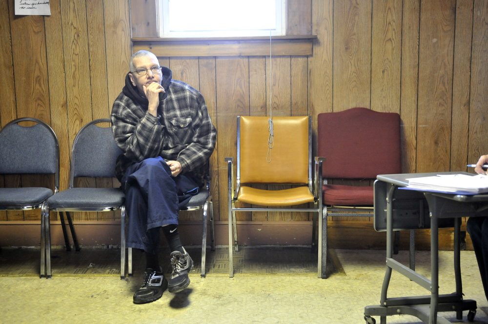 Waiting: Joe Lessard, 49, of Benton, waits for his order to be filled at the food pantry at the First Baptist Church in Fairfield on Thursday. Lessard is picking up an order for seven people.