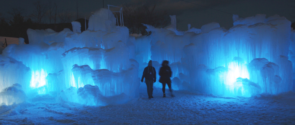 Visitors tour an ice castle at the base of the Loon Mountain ski resort in Lincoln, N.H. The castle has an enclosed slide and a waterfall, and at night is lit by LEDs embedded in the ice. About 8,000 people have visited the castle since it opened Dec. 27. Others are being built in Colorado and Utah.