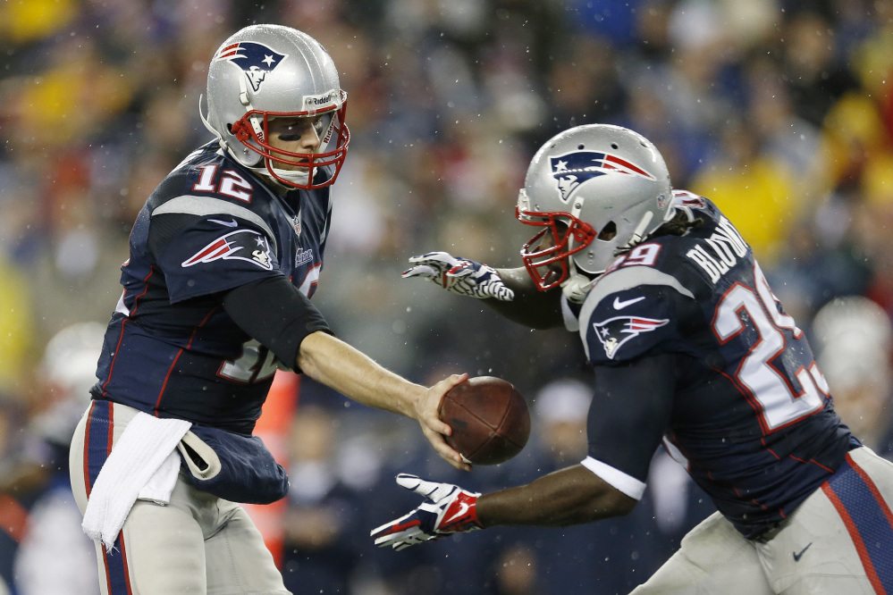 EMBRACING THEIR ROLE: quarterback Tom Brady, left, and running back LeGarrette Blount both expect the Patriots to be underdogs when they face the Denver Broncos in the AFC Championship game on Sunday.