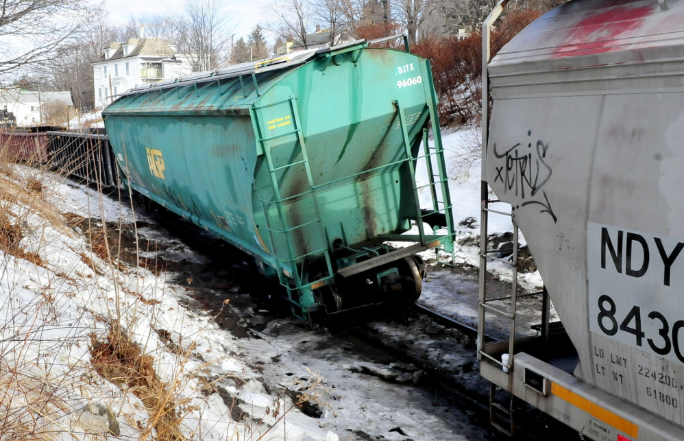 TWISTED RAIL: A railroad car is leaning to the side on a twisted rail along Bay Street in Winslow on Wednesday.