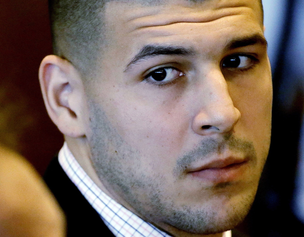 Former New England Patriot football player Aaron Hernandez is awaiting trial on murder charges in a 2013 shooting near his home.