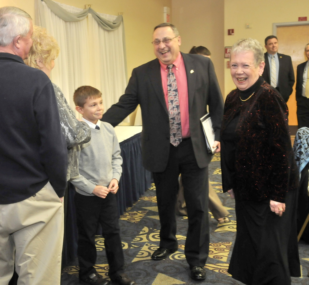 NEW FRIENDS: Gov. Paul LePage laughs with Kaden Fitzmorris, 8, at the Maine Children's Home for Little Wanderers at the annual dinner at the Elks Lodge in Waterville.