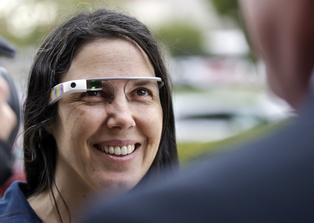 Cecilia Abadie wears her Google Glass as she talks with her attorney outside San Diego traffic court in this Dec. 3, 2013, photo.