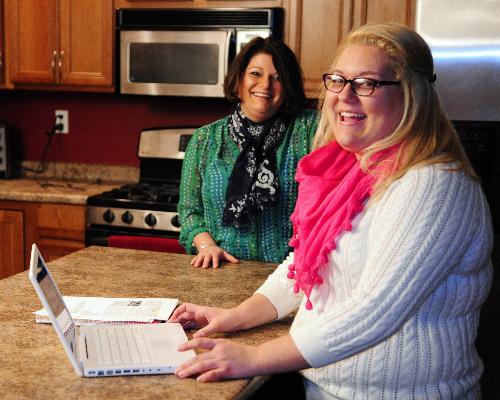 APPLYING: Erica Bean, left, and her daughter Hanna Turgeon talk about applying for college financial aid Wednesday at their Sidney home. Turgeon plans to study nursing at University of Maine at Fort Kent.