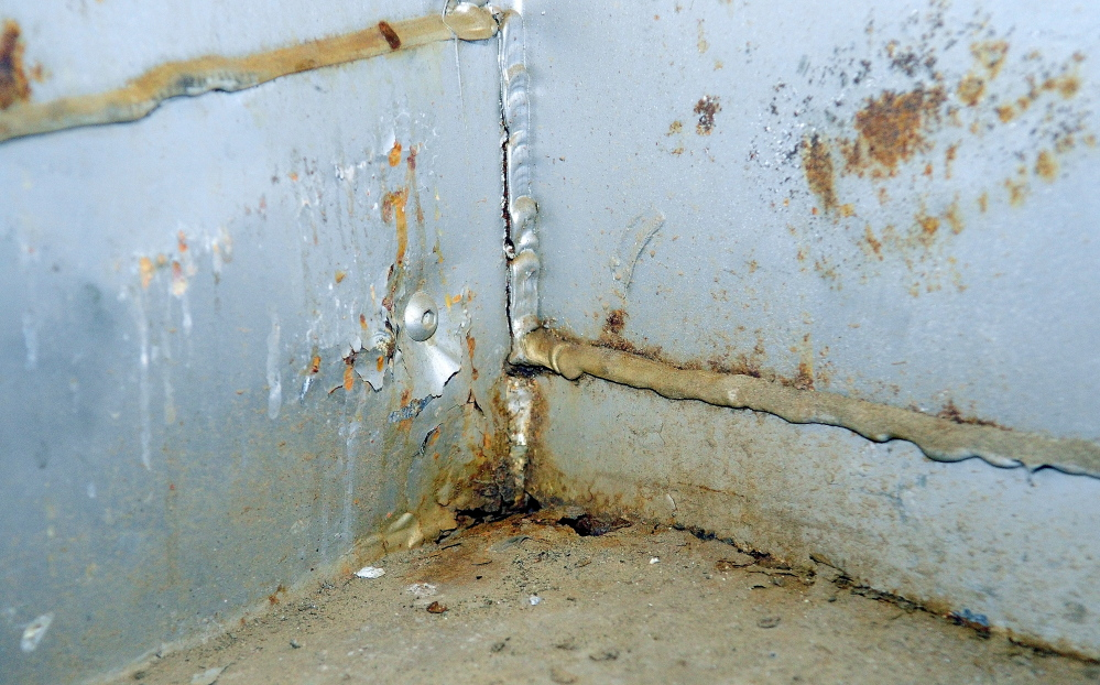Staff photo by Joe Phelan Whitefield Fire Department's 1980 FMC tanker shows rust damage in the photo taken on Friday January 17, 2014 in Coopers Mills Fire Station.