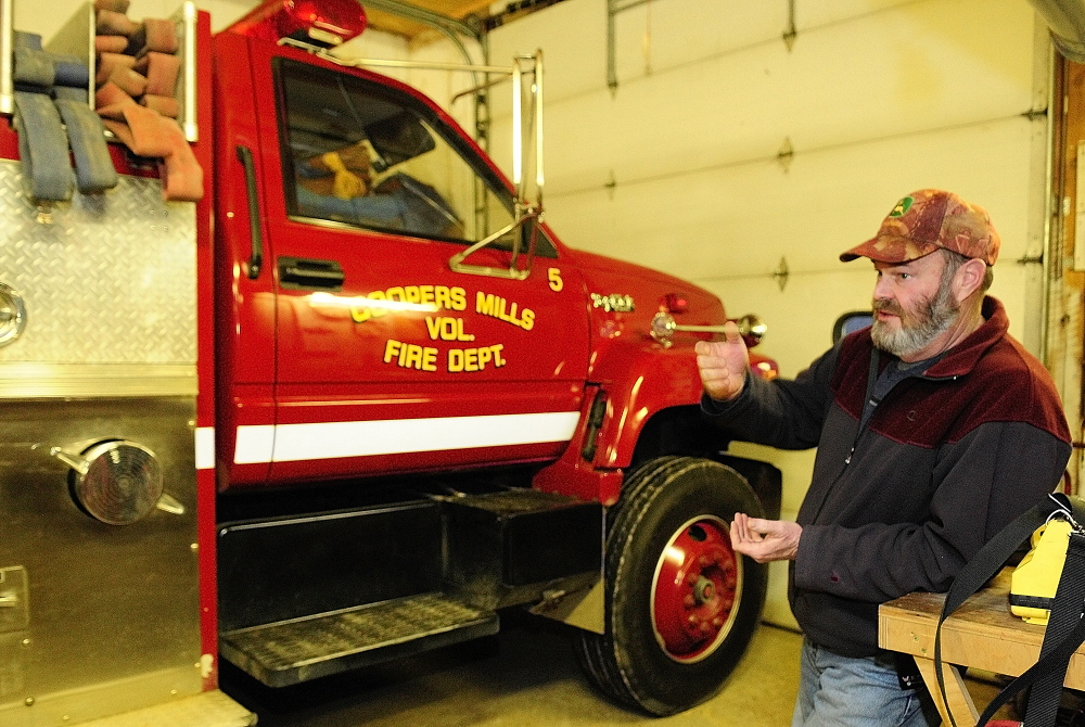 Staff photo by Joe Phelan Whitefield Fire Chief Scott Higgins talks about the department's 1993 pumper during an interview on Friday January 17, 2014 in Coopers Mills Fire Station. There are plans to replace both it and another truck with one new truck.