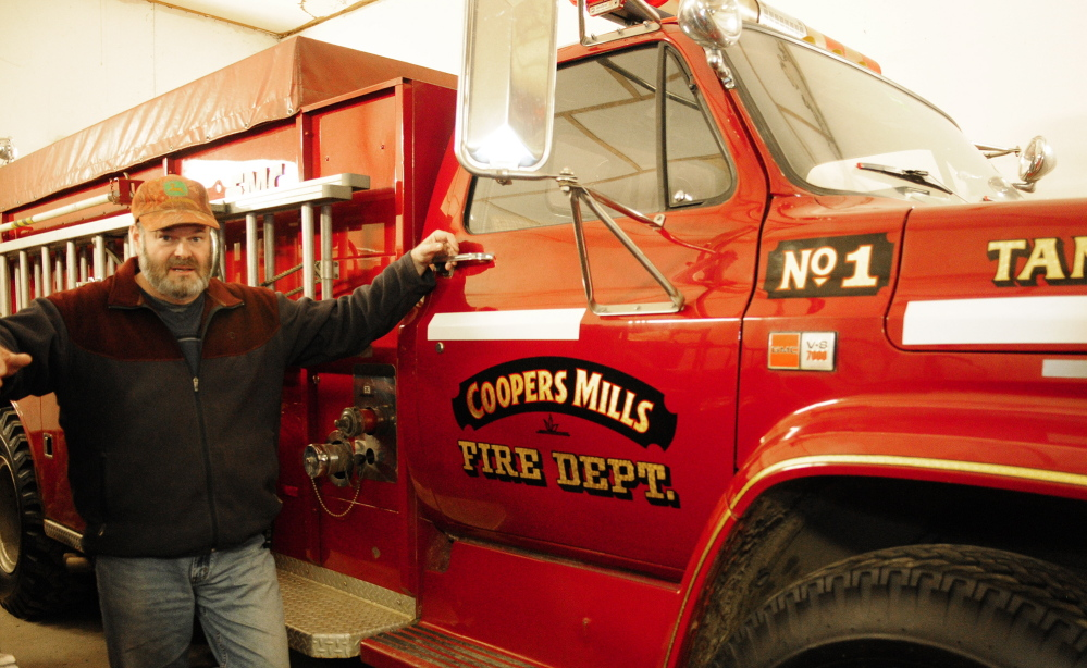 Staff photo by Joe Phelan Whitefield Fire Chief Scott Higgins talks about the department's 1980 FMC tanker during an interview on Friday January 17, 2014 in Coopers Mills Fire Station. There are plans to replace both it and another truck with one new truck.