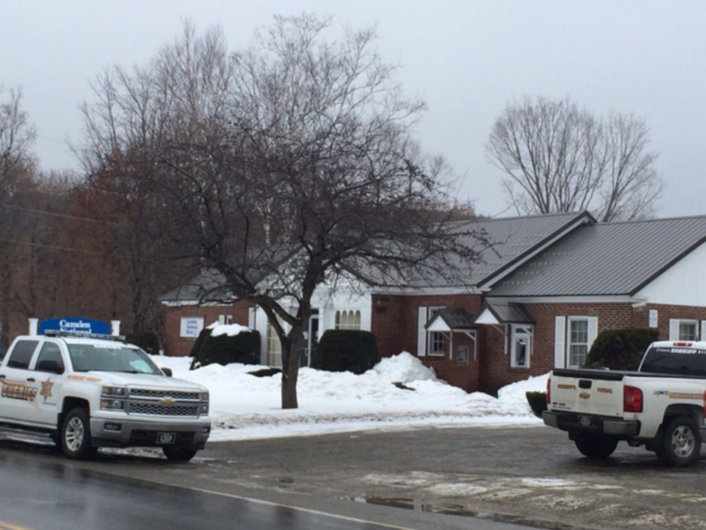 Somerset County Sheriff's officers on scene Friday at Camden National Bank on Main Street in Bingham, which was robbed by a man armed with a hammer.