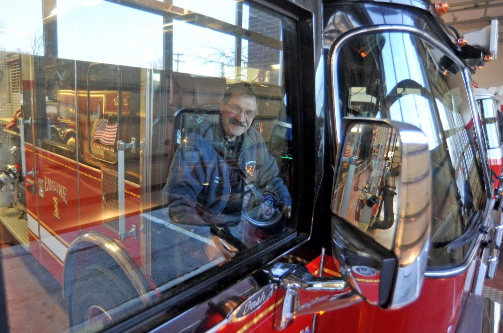 last ride: Capt. Richard Knight takes the front seat for his last ride home at his retirement party at the Farmington fire station on Friday. Knight served the Farmington community as a firefighter for 35 years.