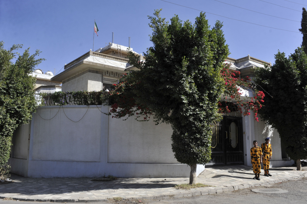 Yemeni soldiers stand guard in front of the Iranian Ambassador's residence in Sanaa, Yemen, on Saturday. Officials in Yemen said an Iranian diplomat has been killed in a drive-by shooting in the capital, Sanaa.