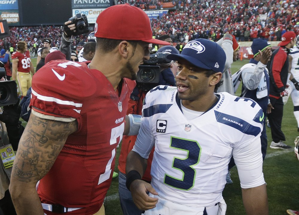 49ers quarterback Colin Kaepernick, left, meets with Seahawks quarterback Russell Wilson after a Dec. 8 game in San Francisco. They will meet again Sunday in the NFC championship game in Seattle.
