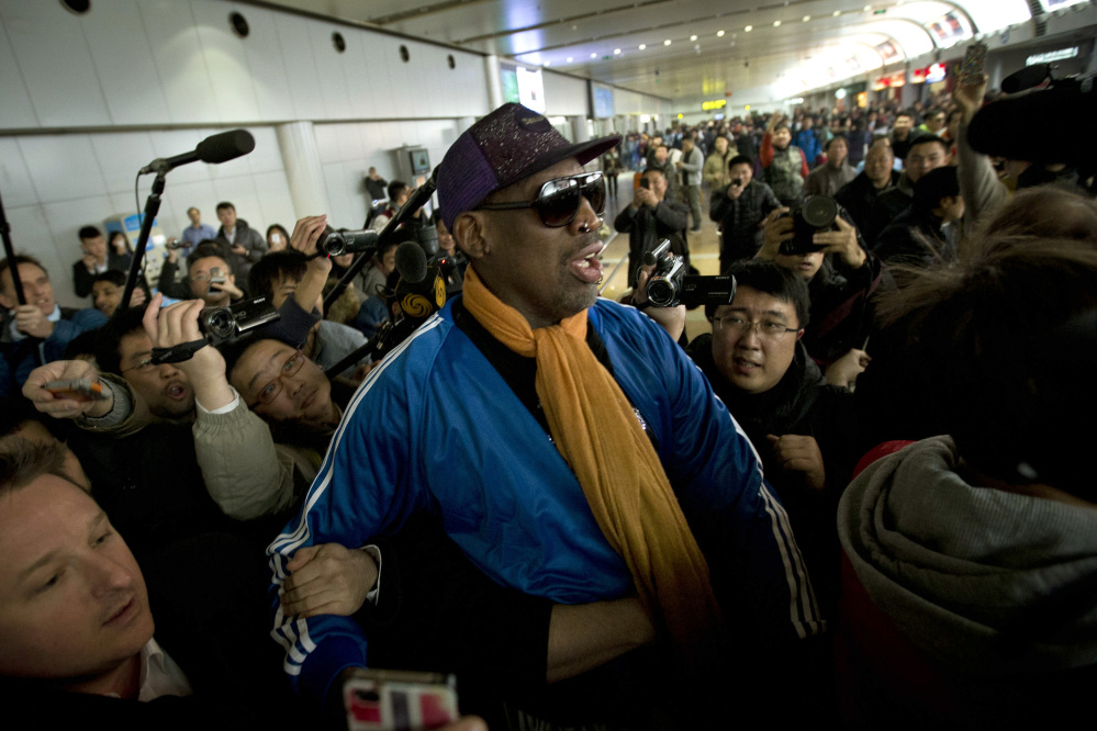 Dennis Rodman is followed by journalists as he arrives at the Capital International Airport in Beijing from Pyongyang, Monday.