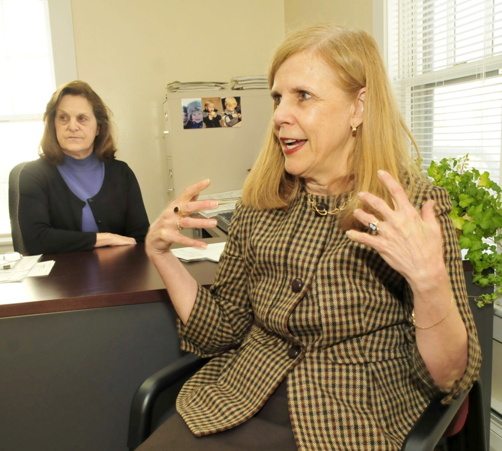 PARTNERS: Celeste Branham, right, vice president of Student and Community Services at the University of Maine in Farmington, and grant writer Lorraine Pratt discuss the Partnership for Civic Advancement program, which assists students with internship opportunities.