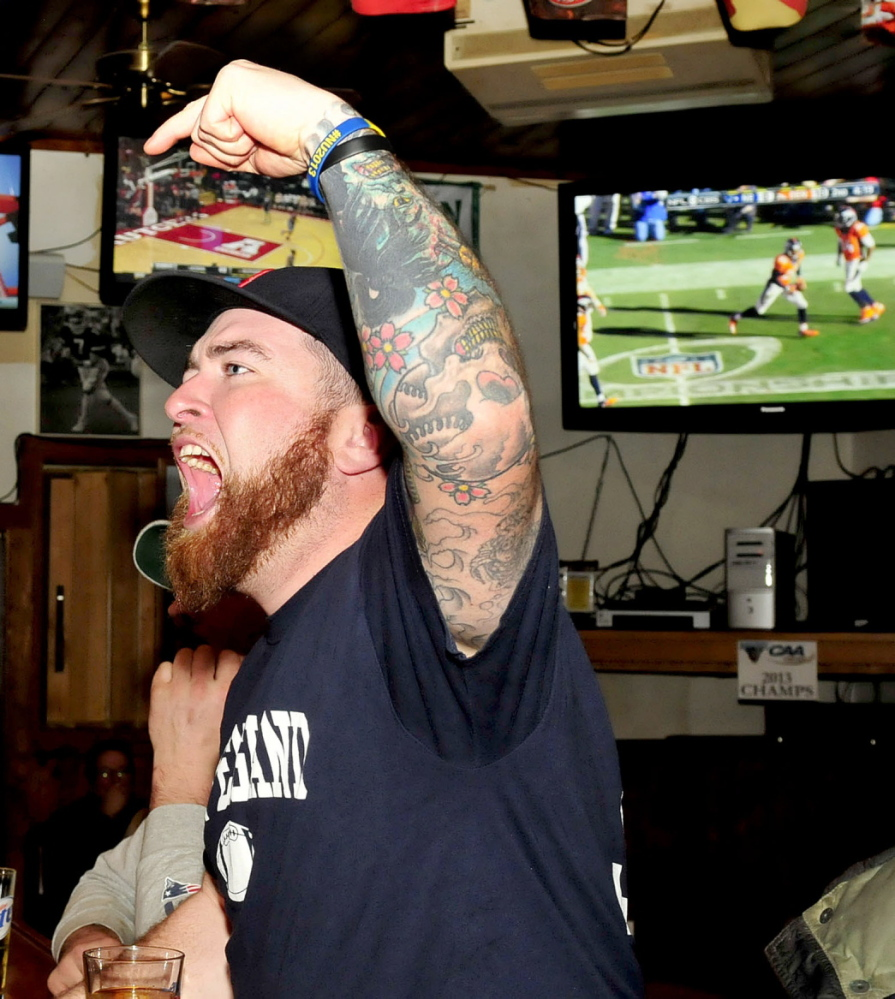 Staff photo by David Leaming GOOD CALL: NewEngland Patriots fan Timbo Jones reacts to a referee call in favor of the Patriots during game against the Denver Broncos at the Pointe Afta in Winslow on Sunday, Jan. 19, 2014.
