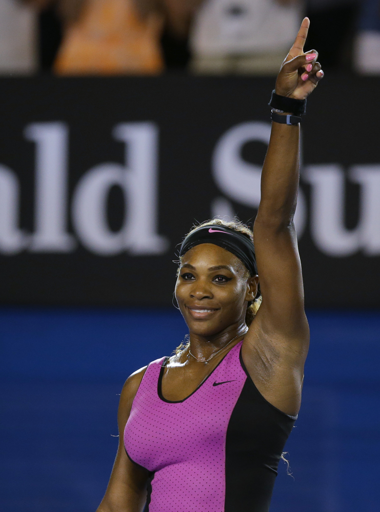 Serena Williams of the United States celebrates after defeating Ashleigh Barty of Australia in their first round match at the Australian Open tennis championship in Melbourne, Australia, Monday, Jan. 13, 2014.(AP Photo/Aaron Favila)