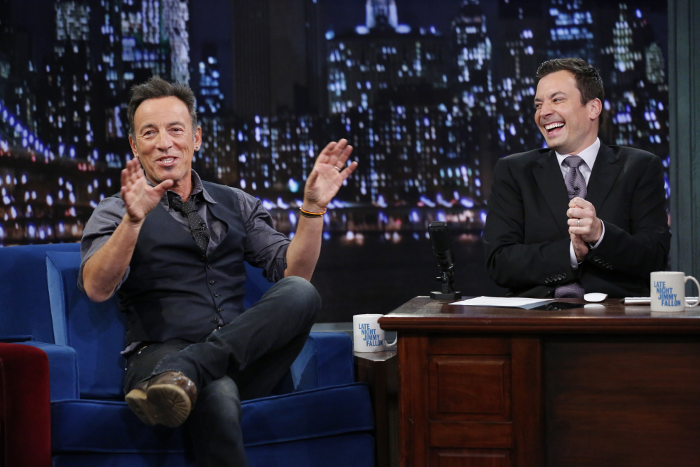 "This image released by NBC shows Bruce Springsteen, left, with host Jimmy Fallon during an recent appearance on ""Late Night with Jimmy Fallon."""