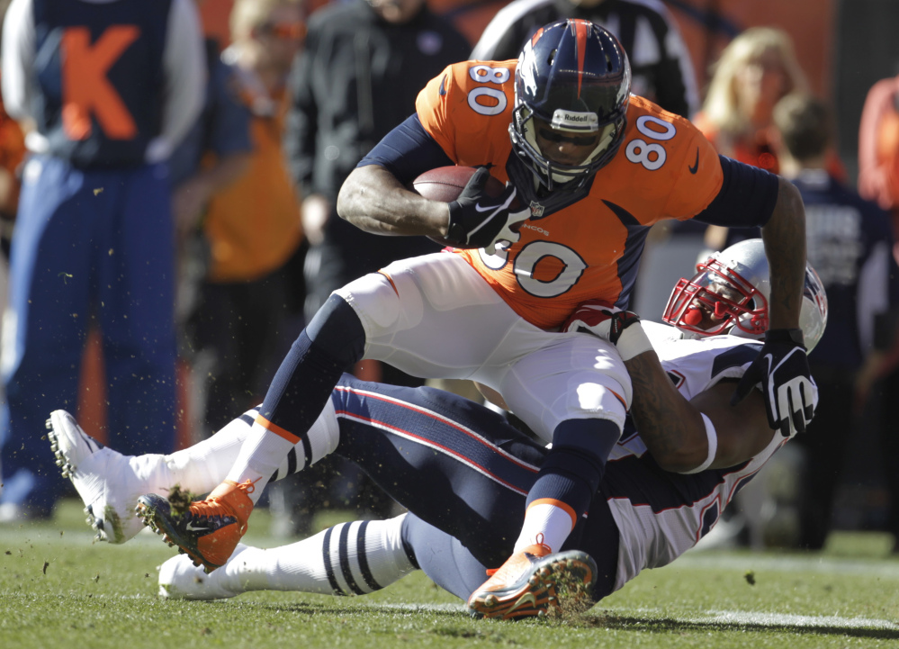Broncos tight end Julius Thomas is stopped by Patriots outside linebacker Dont'a Hightower in the first half Sunday at Denver.