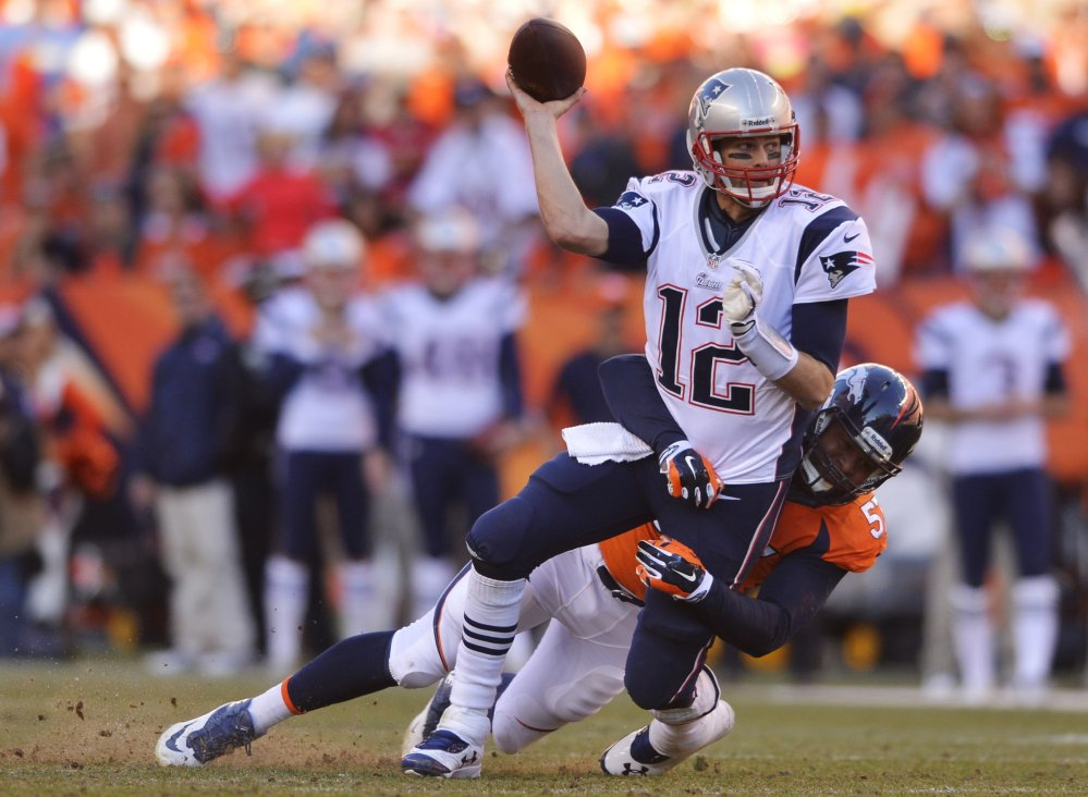 New England Patriots quarterback Tom Brady (12) is hauled to the turf by Denver Broncos defensive end Jeremy Mincey (57) during the second half of the AFC Championship NFL playoff football game in Denver, Sunday, Jan. 19, 2014. (AP Photo/Jack Dempsey)