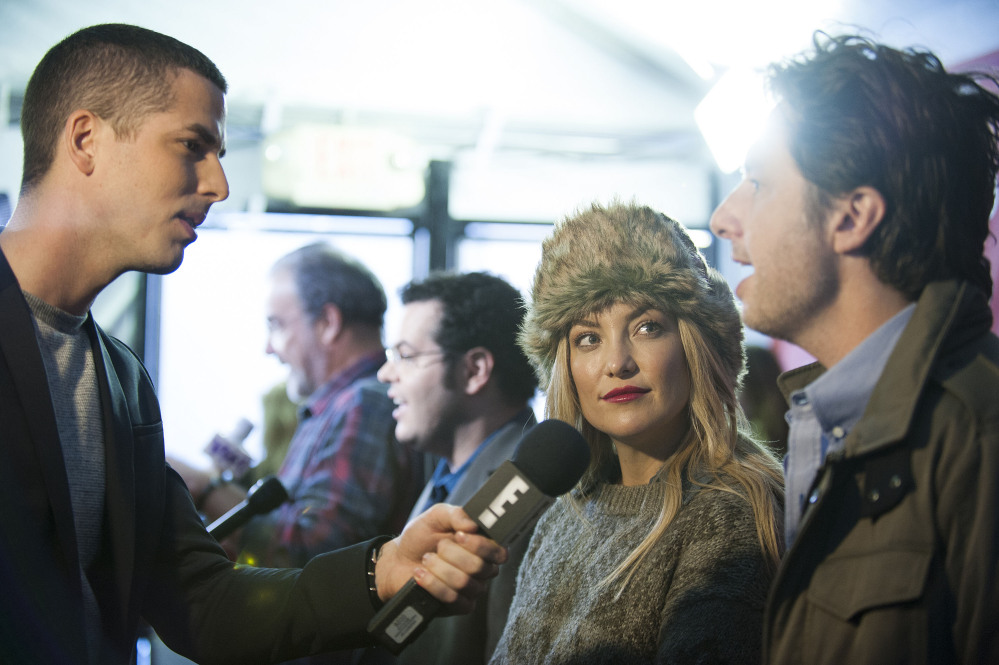 """Actress Kate Hudson looks up at director/co-writer Zach Braff as they are being interviewed at the premiere of the film """"Wish I Was Here"""" during the 2014 Sundance Film Festival on Saturday in Park City, Utah."""