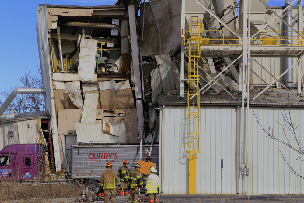 Firefighters stage operations outside the International Nutrition plant in Omaha, Neb., Monday, where 38 people were working when there was an explosion and fire there.