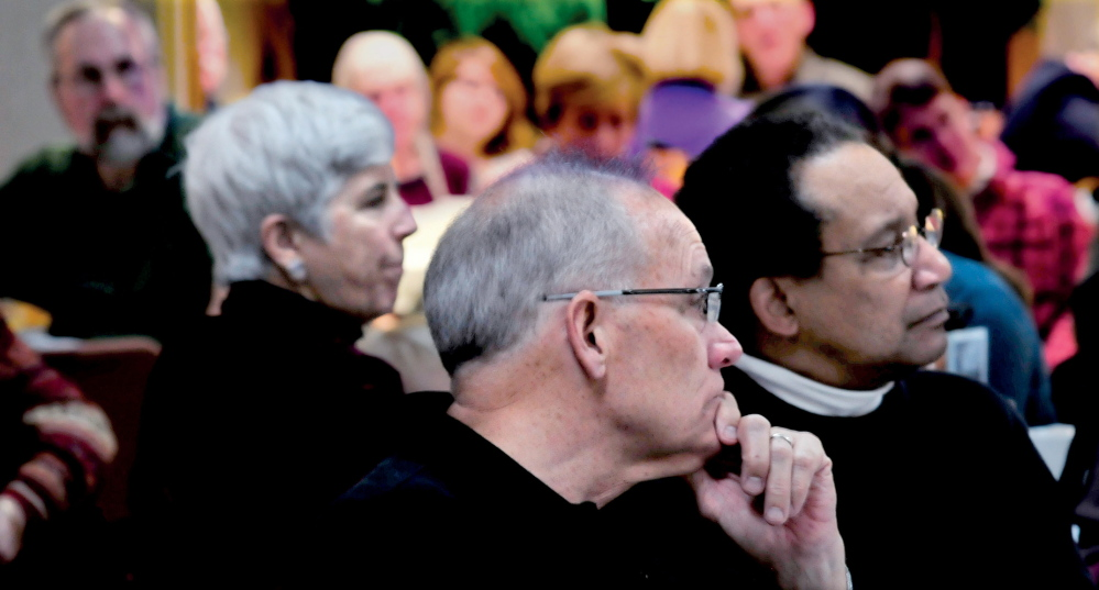 """REMEMBRANCE: The Senior Spectrum Muskie Center in Waterville was filled with people for the annual Martin Luther King Jr. community breakfast on Monday. Listening from left are Sally Harwood, Bud Vassey and David Deas. """"We see people here we may see only once a year,"""" Deas said. """"We talk about peace and civil rights."""""""