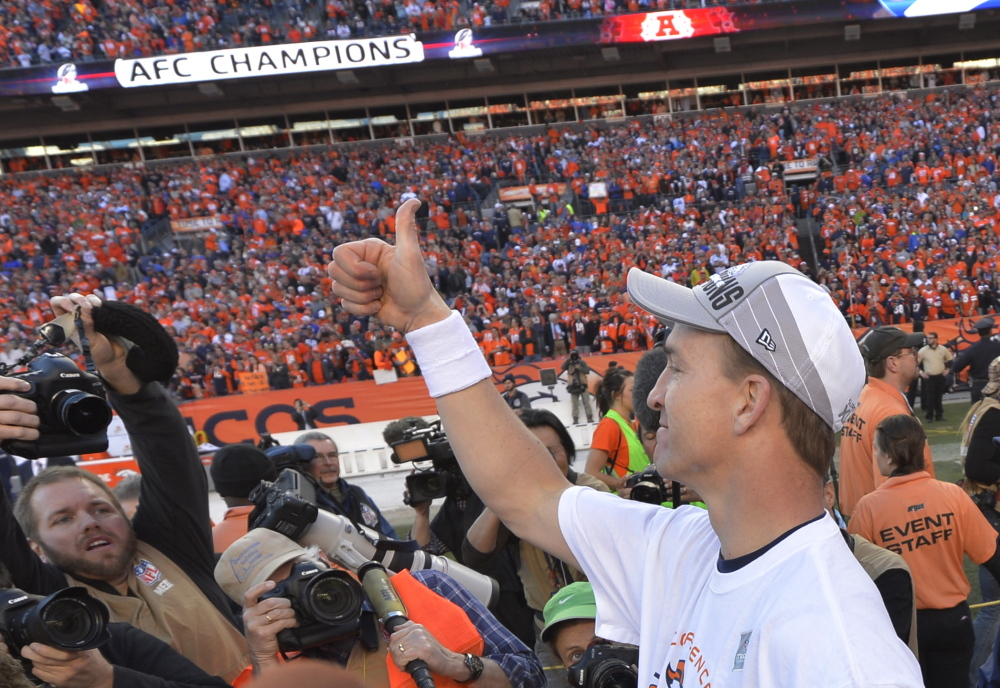 Denver Broncos quarterback Peyton Manning flashes a thumbs up after the AFC Championship NFL playoff football game against the New England Patriots in Denver Sunday. The Broncos defeated the Patriots 26-16 to advance to the Super Bowl.