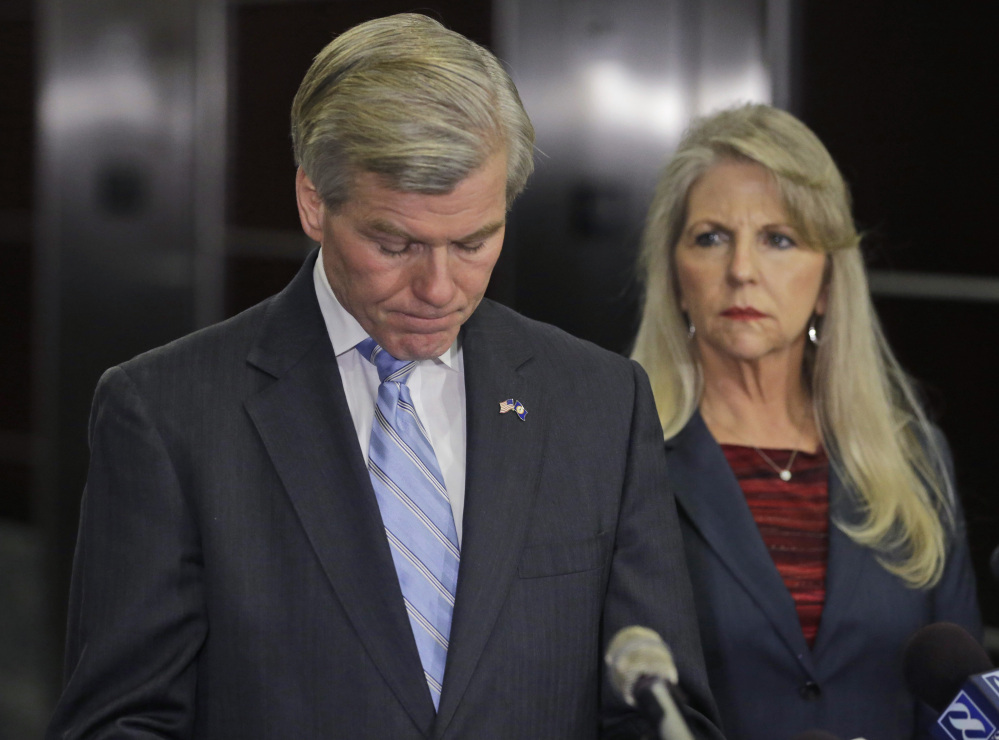Former Virginia Gov. Bob McDonnell pauses while making a statement as his wife, Maureen, right, listens during a news conference in Richmond, Va., Tuesday, Jan. 21, 2014. McDonnell and his wife were indicted Tuesday on corruption charges after a monthslong federal investigation into gifts the Republican received from a political donor.