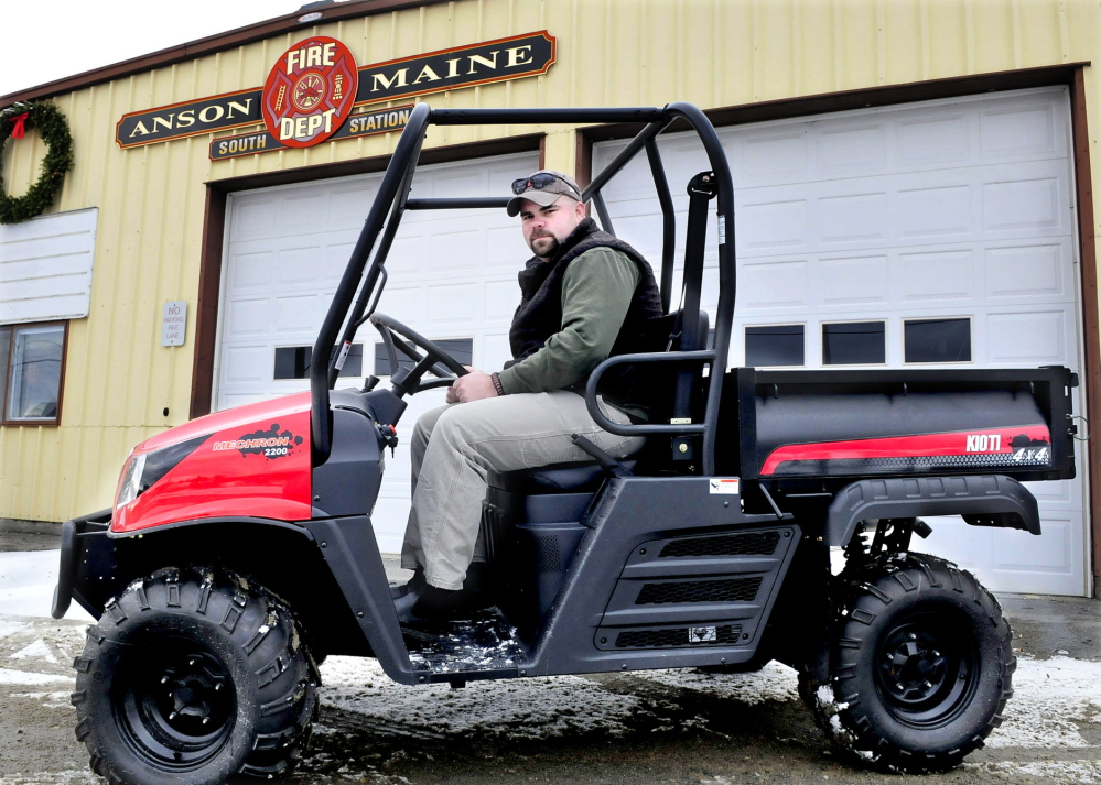 WORK VEHICLE: Anson Fire Chief Jeremy Manzer sits behind the wheel of the new department ultimate terrain vehicle that will be used for off-road access to emergency scenes.
