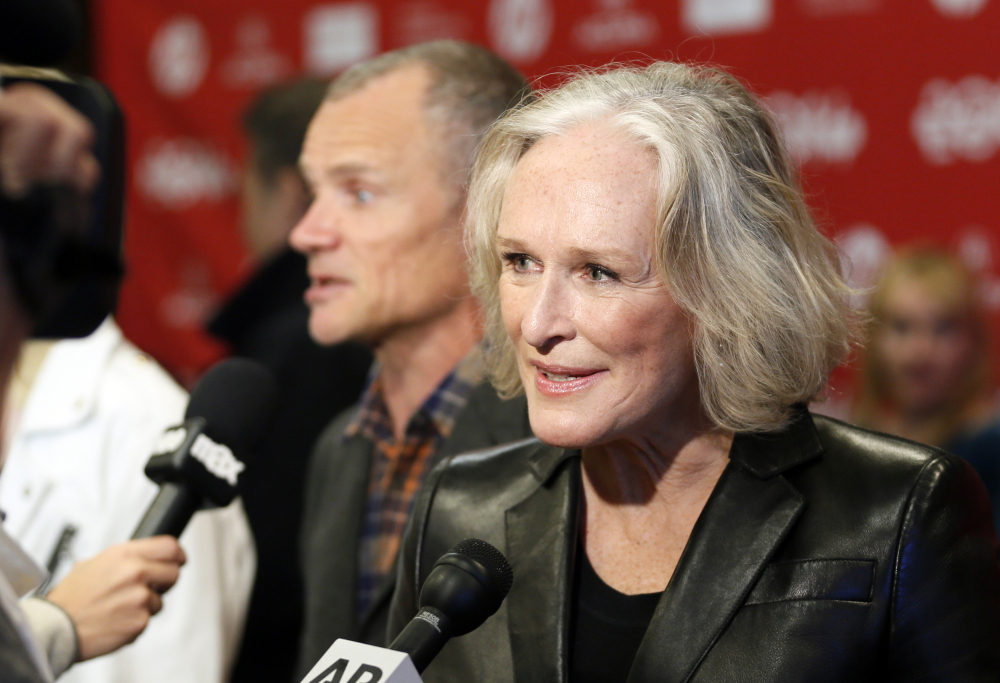 """Low Down"" cast member Glenn Close speaks with reporters as fellow cast member Flea, rear, of the Red Hot Chili Peppers, is also interviewed at the premiere of the film Sunday at the 2014 Sundance Film Festival, in Park City, Utah."