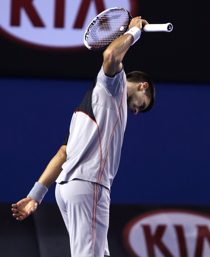 Novak Djokovic of Serbia reacts after losing a point during his quarterfinal against Stanislas Wawrinka of Switzerland at the Australian Open tennis championship in Melbourne, Australia, Tuesday, Jan. 21, 2014.(AP Photo/Aaron Favila)
