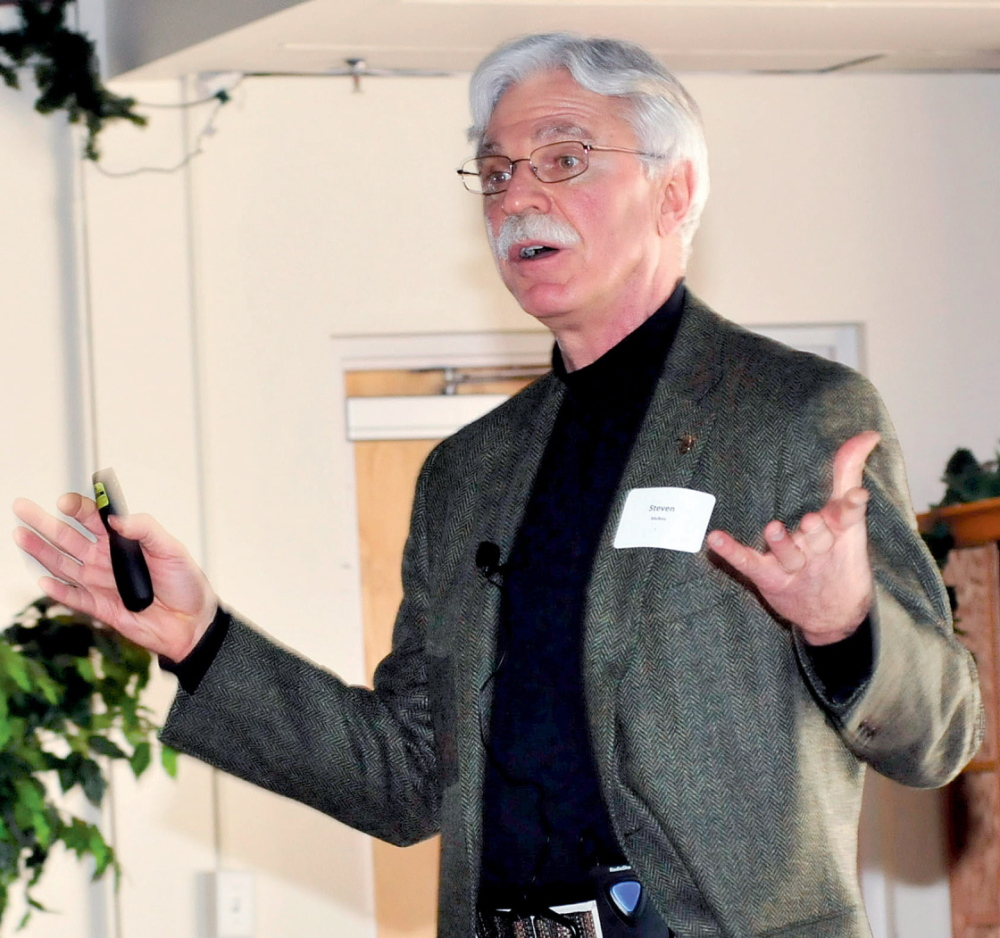 CHANGES COMING: Steven Mulkey, president of Unity College, speaks about environmental reform during a Mid-Maine Global Forum event in Waterville on Wednesday.
