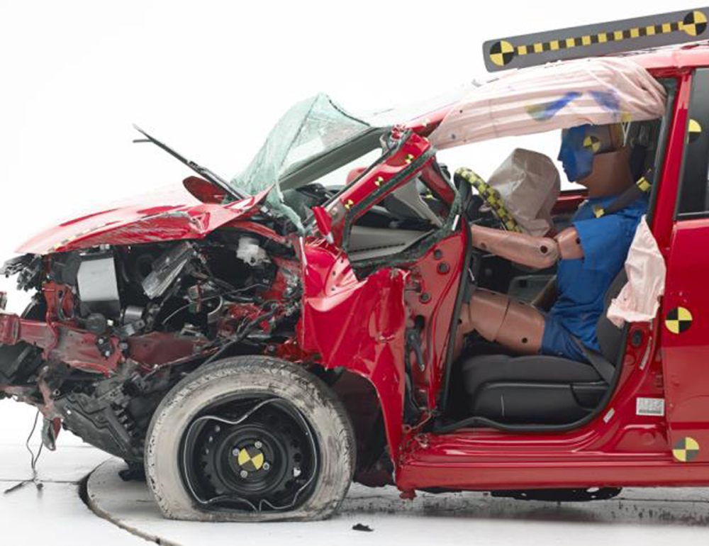 The Honda Fit's steering column was pushed so far into the vehicle in the crash test that the dummy's head slid off the air bag and hit the instrument panel.